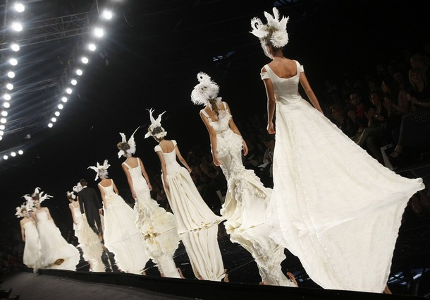 Models present creations from Victorio & Lucchino collection at Barcelona Bridal Week fashion show