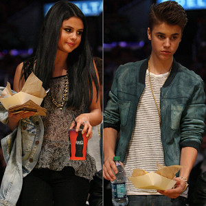Justin Bieber and girlfriend Selena Gomez enjoy a kiss while sitting courtside at the Los Angeles Laker Vs San Antonio Spurs game in Los Angeles, Ca