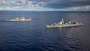 ships_meeting_warships_at_sea_094538_